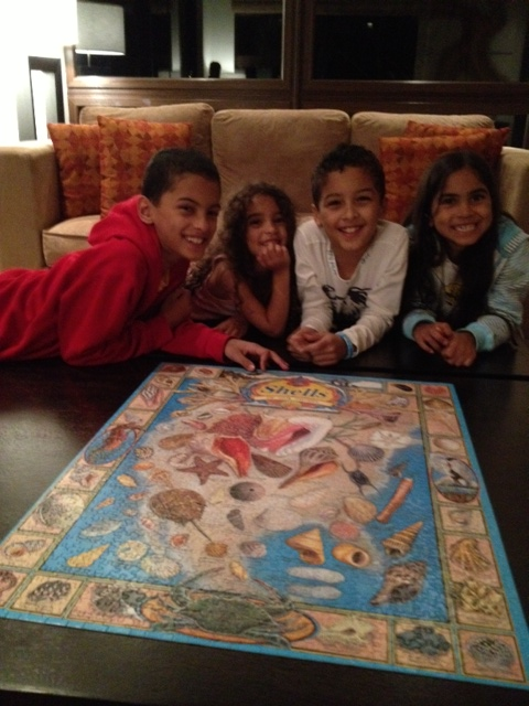 Kids with 1,000 piece puzzle