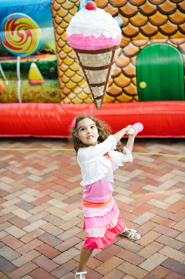 Child playing with Pinata