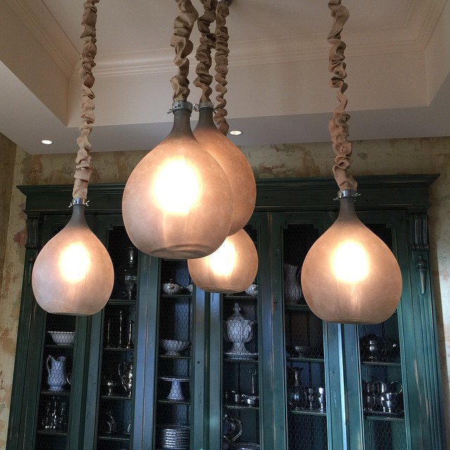 Clear glass jugs sandblasted and faux painted into a light fixture with burlap cord covers. #vignetteme