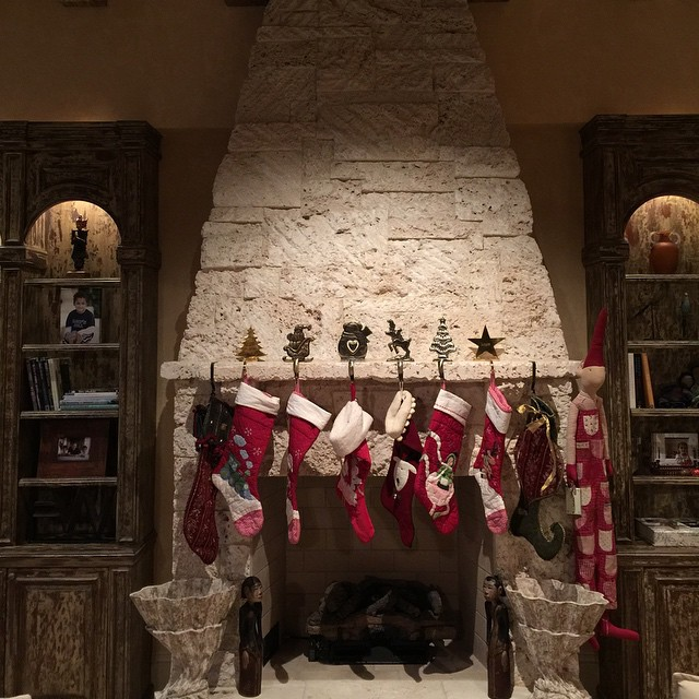 The stockings were hung by the Fake South Florida Fireplace with care...